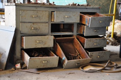 opened and empty drawers of an old furniture